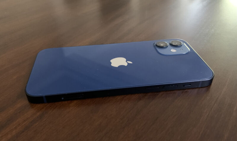 A blue iPhone 12 lying flat on a table