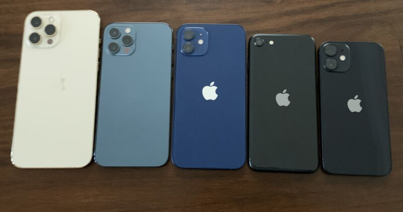 Five iPhones on a table