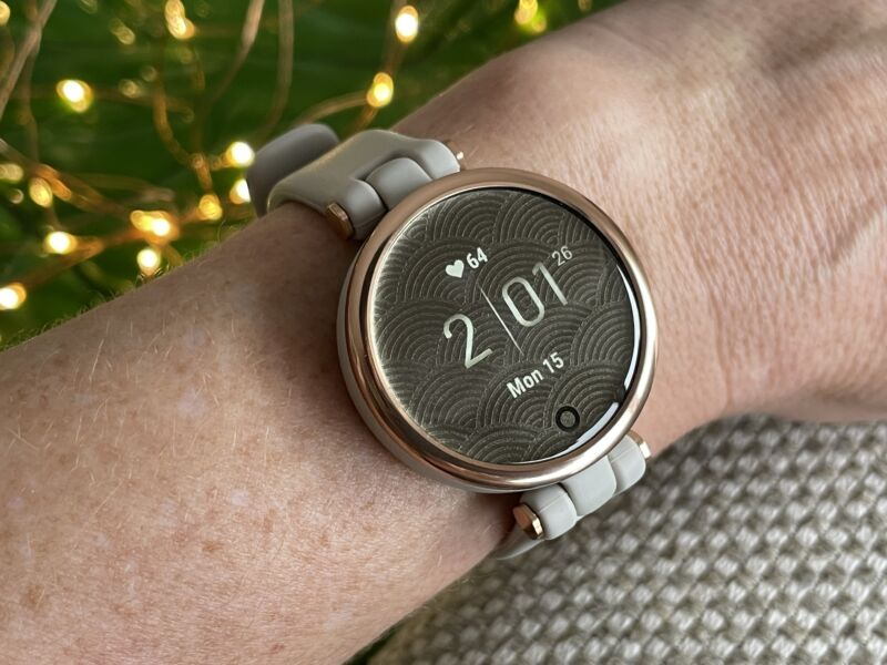 A garmin lily wearable on a woman's wrist