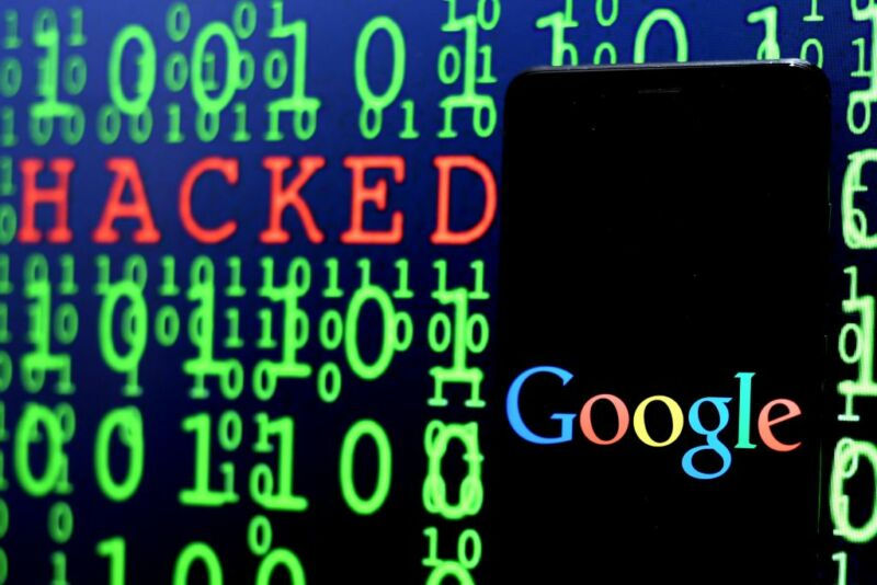A computer screen filled with ones and zeros also contains a Google logo and the word hacked.